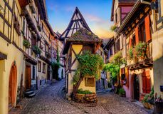Colorful half-timbered houses in Eguisheim, Alsace, France. Traditional colorful halt-timbered houses in Eguisheim Old Town on Alsace Wine Route, France stock image