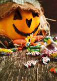 Colorful Halloween candy and Jack-o-lantern Stock Image
