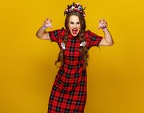 Young woman in halloween costume frightening Royalty Free Stock Image