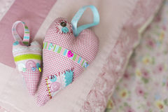 The colorful hamdmade textile big and small toy hearts Stock Photos