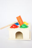 Colorful hammer case wooden toy on white table Royalty Free Stock Photos
