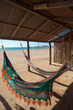 Colorful hammocks on a beautiful deserted bach Royalty Free Stock Photo