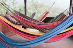 Colorful hammocks hanging at the veranda royalty free stock photos
