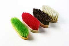 Colorful hand brushes. Several large hand brushes with colorful bristles.  White background Stock Image