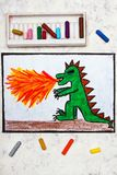 Colorful hand drawing: dragon spitting fire. royalty free stock photography
