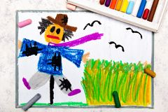 Colorful hand drawing: scary scarecrow. Next to the grain field vector illustration