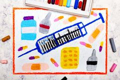 Colorful hand drawing: syringe and pills. stock images