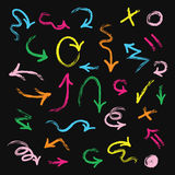 Colorful hand drawn arrows set on black background. Colorful different hand drawn arrows set on black background Royalty Free Stock Photo