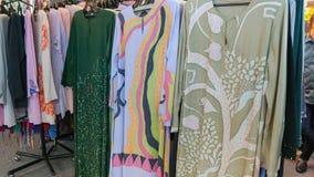 Baju kurung Kaftan or caftan. Colorful hand dyed baju kurung kaftan clothing for sale Stock Photos