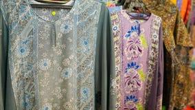 Baju kurung kaftan or caftan. Colorful hand dyed baju kurung kaftan clothing for sale Stock Photography