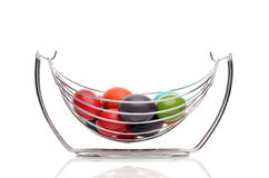 Colorful hand dyed easter eggs in a stainless steel nest holder. Royalty Free Stock Images