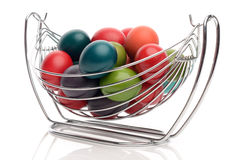 Colorful hand dyed easter eggs in a stainless steel nest holder. Royalty Free Stock Photography