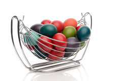 Colorful hand dyed easter eggs in a stainless steel nest holder. Stock Photography