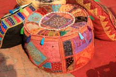 Colorful hand made cushions and bean bag. At Dilli Haat ( an indian craft market) at New Delhi, India royalty free stock photos