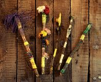 Colorful hand made decorated magic wands on witch table, top view. Occult, esoteric, divination and wicca concept. Halloween vintage background stock image
