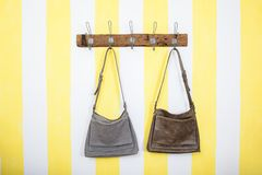 Leather bags on striped wallpaper royalty free stock photos