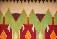 Colorful hand made motley rug or carpet. Close up of beautiful colorful hand made motley rug or carpet Stock Photo