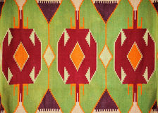 Colorful hand made motley rug or carpet. Close up of beautiful colorful hand made motley rug or carpet Stock Photos