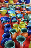 Colorful hand-made pottery for sale at market. A variety of hand-made colorful sandstone  pottery is for sale at an outdoor market Stock Photo