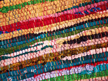 Colorful hand made rug mat. Closeup view of a colorful hand made woven rug mat Stock Photography