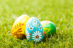 Colorful hand painted Easter eggs in grass. Spring theme Stock Images