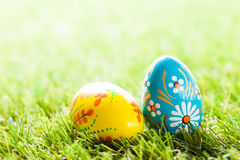 Colorful hand painted Easter eggs in grass. Spring theme. Traditional decoration, unique handmade design Royalty Free Stock Image
