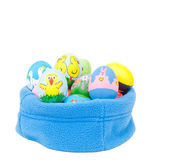 Colorful hand painted Easter eggs nested in fleece Royalty Free Stock Image