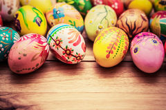 Colorful hand painted Easter eggs on wood. Unique handmade, vint Stock Photo