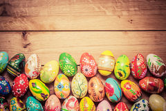 Colorful hand painted Easter eggs on wood. Unique handmade, vintage design. stock image