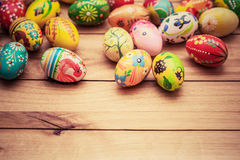 Colorful hand painted Easter eggs on wood. Unique handmade, vintage design. Stock Photos