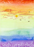 Hand drawn illustration of colorful sunset. Colorful hand painted watercolor illustration of a sunset, with pink clouds and birds flying Royalty Free Stock Photo