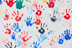Colorful hand prints. Background of colorful hand prints on a wall stock image