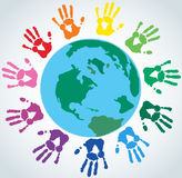 Colorful Hand prints around the earth vector. EPS10 Stock Image