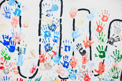 Colorful hand prints. Background of colorful hand prints on a wall royalty free stock photos