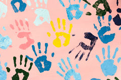Colorful hand prints on pink wall. For background , cover , card , etc royalty free stock photography