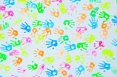 Colorful hand prints on a wall. Background stock image
