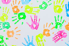 Colorful hand prints on a wall. Colorful hand prints background on a wall royalty free stock image