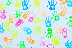 Colorful hand prints on a wall. Backgroynd of colorful hand prints on a wall royalty free stock photo