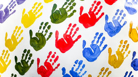 Colorful hand prints. On white wall Stock Photography