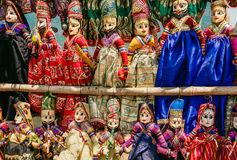 Colorful handcrafted dolls in traditional costumes of India. Marketplace with old style indian toys for children Royalty Free Stock Images