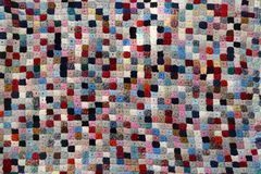Colorful handcrafted patchwork quilt. Pattern woolen yarn Royalty Free Stock Photos