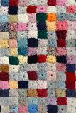 Colorful handcrafted patchwork quilt. Pattern woolen yarn stock photography