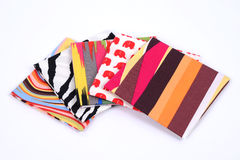 Colorful handkerchief. Folded into a square on white background Stock Photography