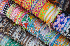 Colorful handmade bracelets made of beads and thread Stock Photos