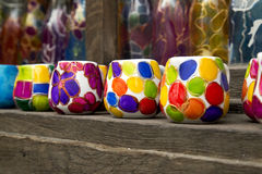 Colorful handmade ceramic cups. Coloured ceramic cups, hand painted on a market shelf Stock Photos