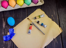 Colorful handmade easter egg with painting brush on old paper . Stock Images