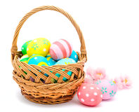 Colorful handmade easter eggs in the basket and flowers  Royalty Free Stock Photos