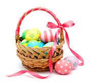 Colorful handmade easter eggs in the basket isolated Royalty Free Stock Photo