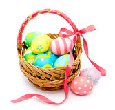Colorful handmade easter eggs in the basket  Royalty Free Stock Images