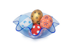Colorful handmade easter eggs in blue tray isolated on a white B Royalty Free Stock Photography